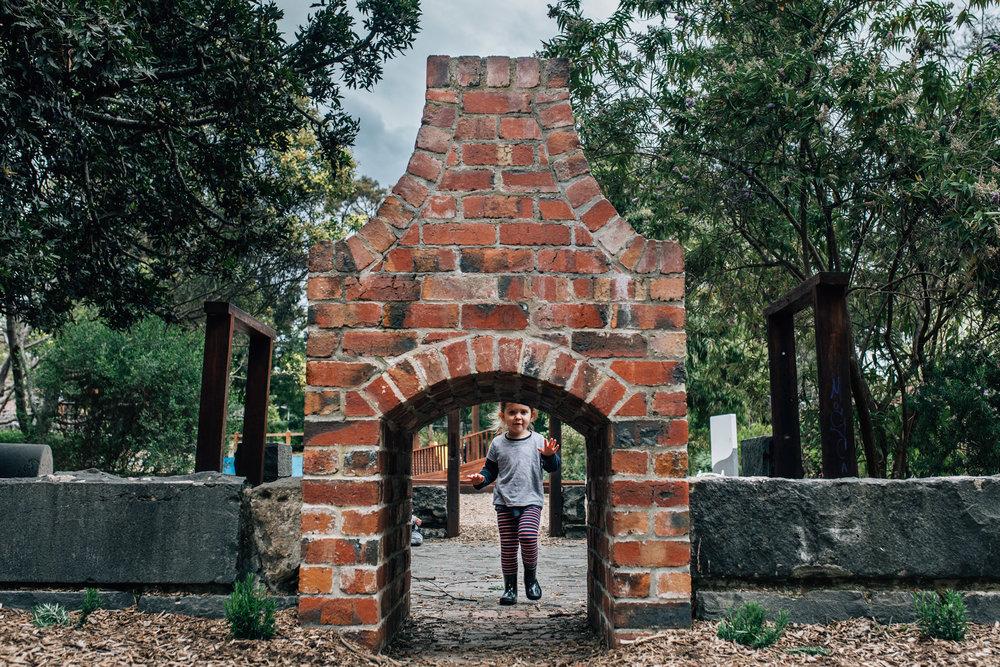 little girl walking through old chimney tunnel (1 of 1).jpg