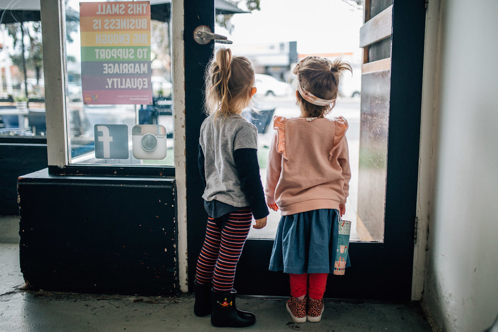 little girls looking out cafe window colour (1 of 1).jpg