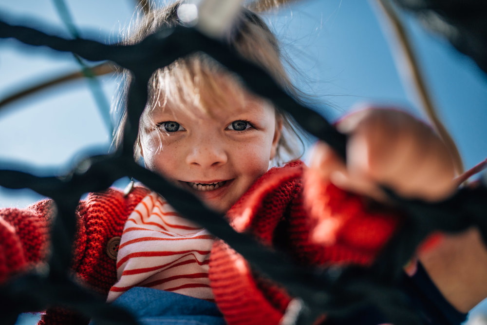 little girl in red cardigan climbing play equipment II (1 of 1).jpg