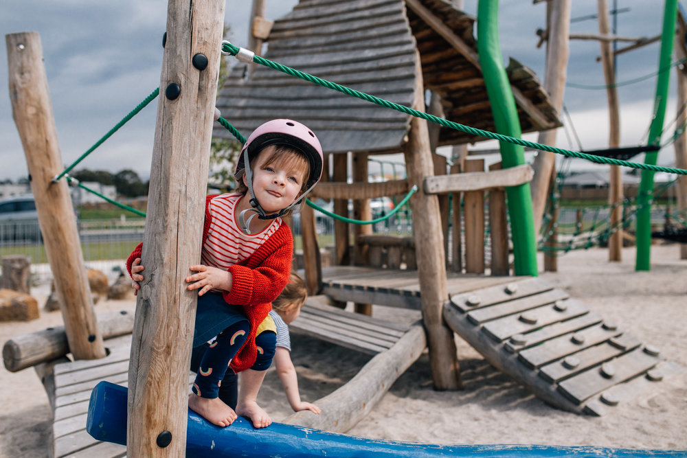 little girl in red cardigan on climbing frame (1 of 1).jpg