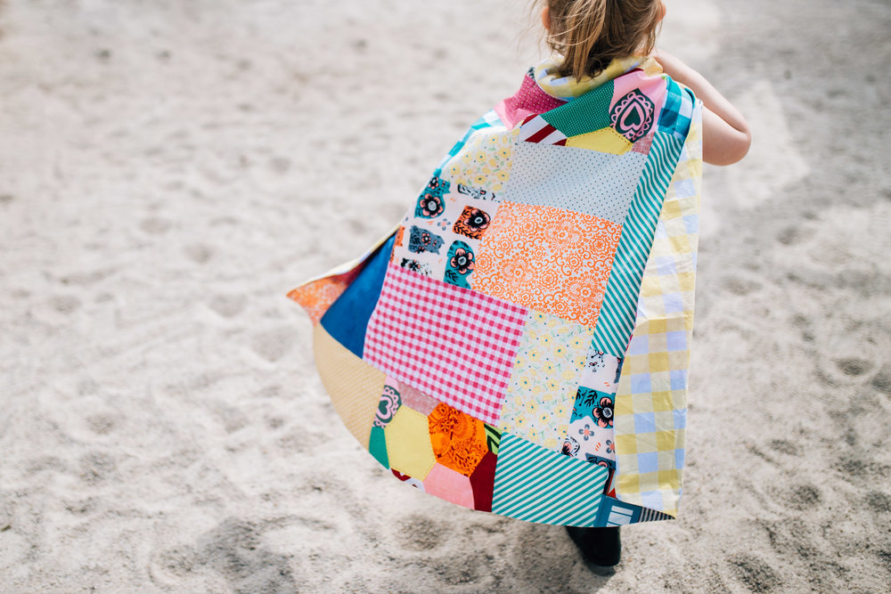 little girl wearing patchwork cape (1 of 1).jpg