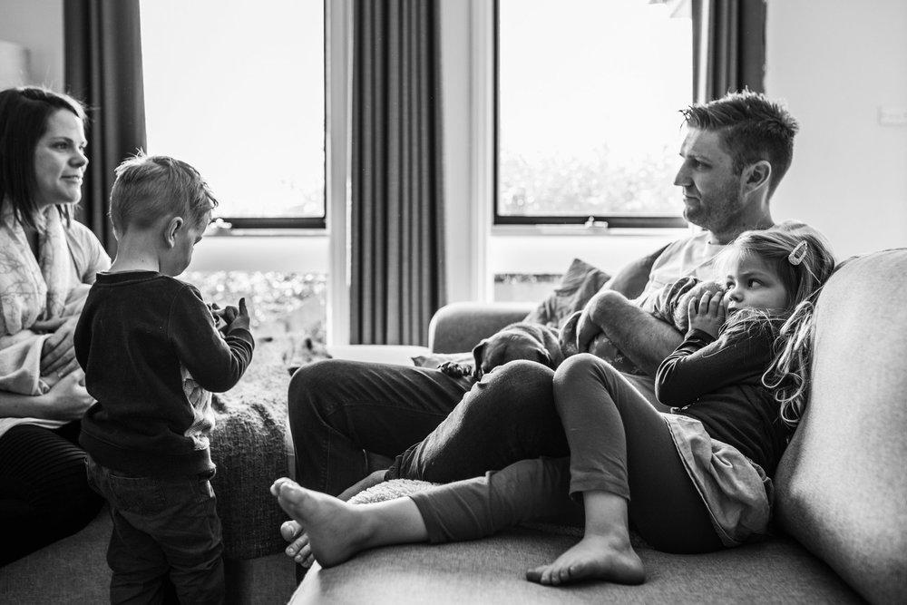 family on sofa with newborn twins II (1 of 1).jpg