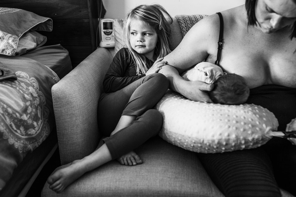 little girl waiting while mum breastfeeds (1 of 1).jpg