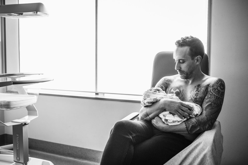 father with tattoos holding new baby (1 of 1).jpg