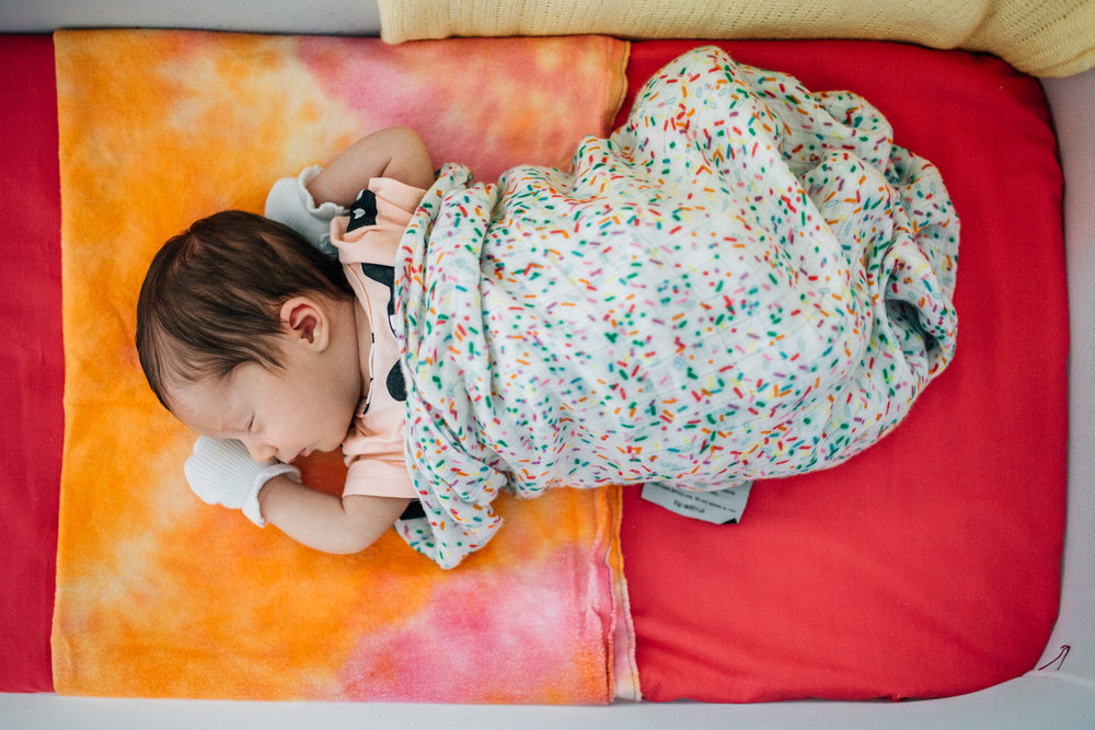 baby girl sleeping in bassinet (1 of 1).jpg