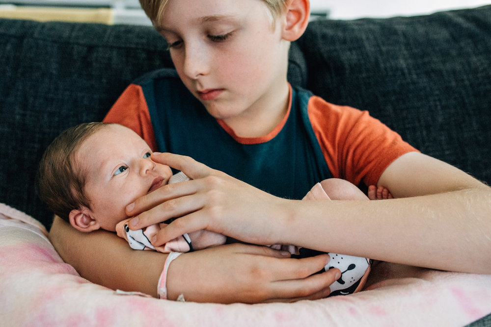 little boy nursing baby sister (1 of 1).jpg