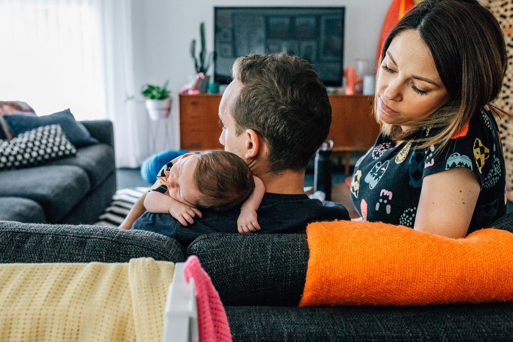 mother father and sleeping baby on sofa (1 of 1).jpg