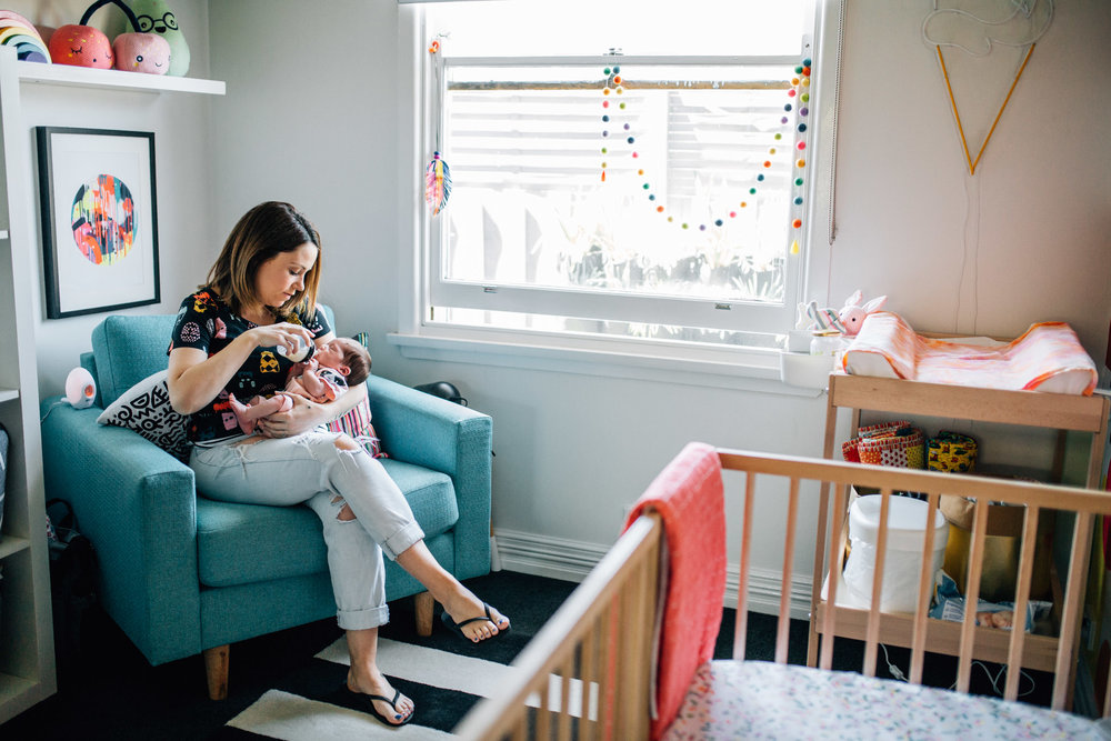 mother sitting in nursery cair feeding baby (1 of 1).jpg