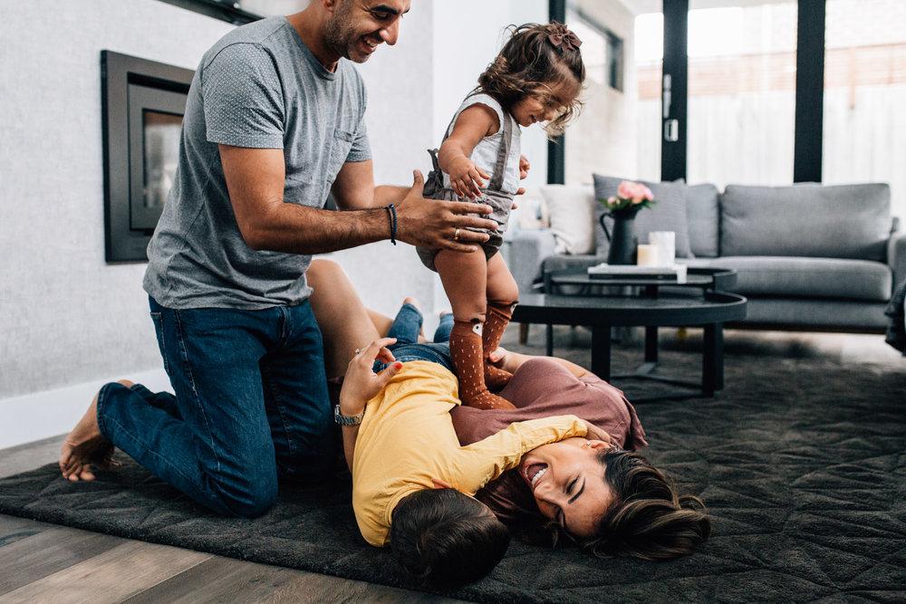 family of four tussling on carpet II (1 of 1).jpg