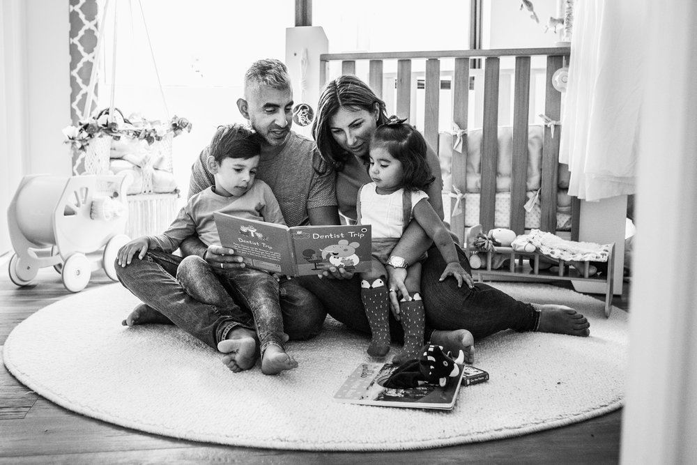 family reading together on nursery room rug (1 of 1).jpg