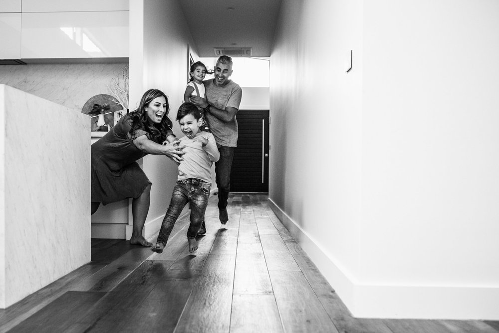 family running through hallway (1 of 1).jpg