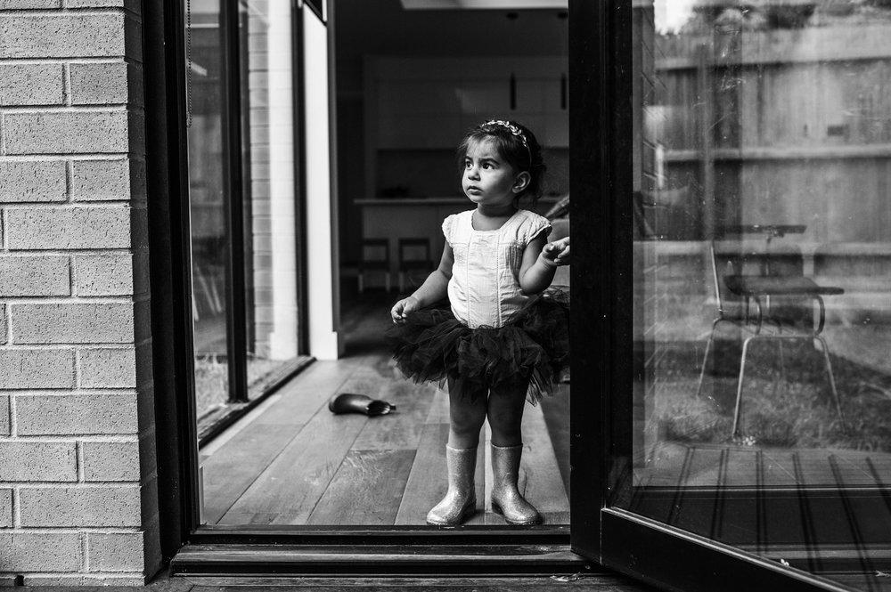 little girl in tutu at back door (1 of 1).jpg