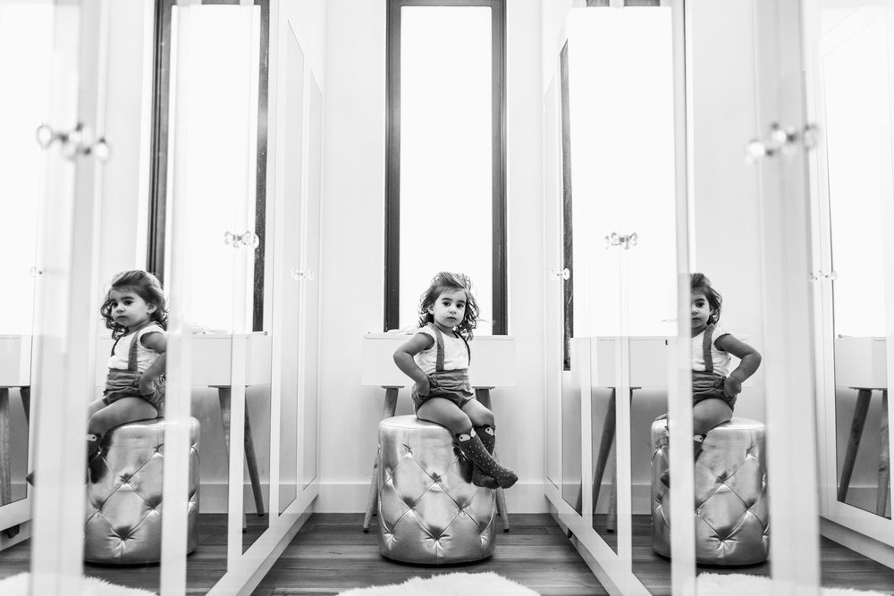 little girl sitting in mothers mirrored closet II (1 of 1).jpg