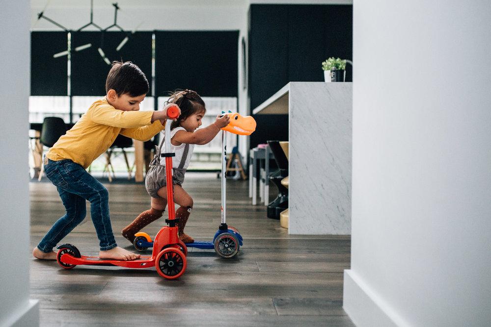 children on scooters in hallway (1 of 1).jpg