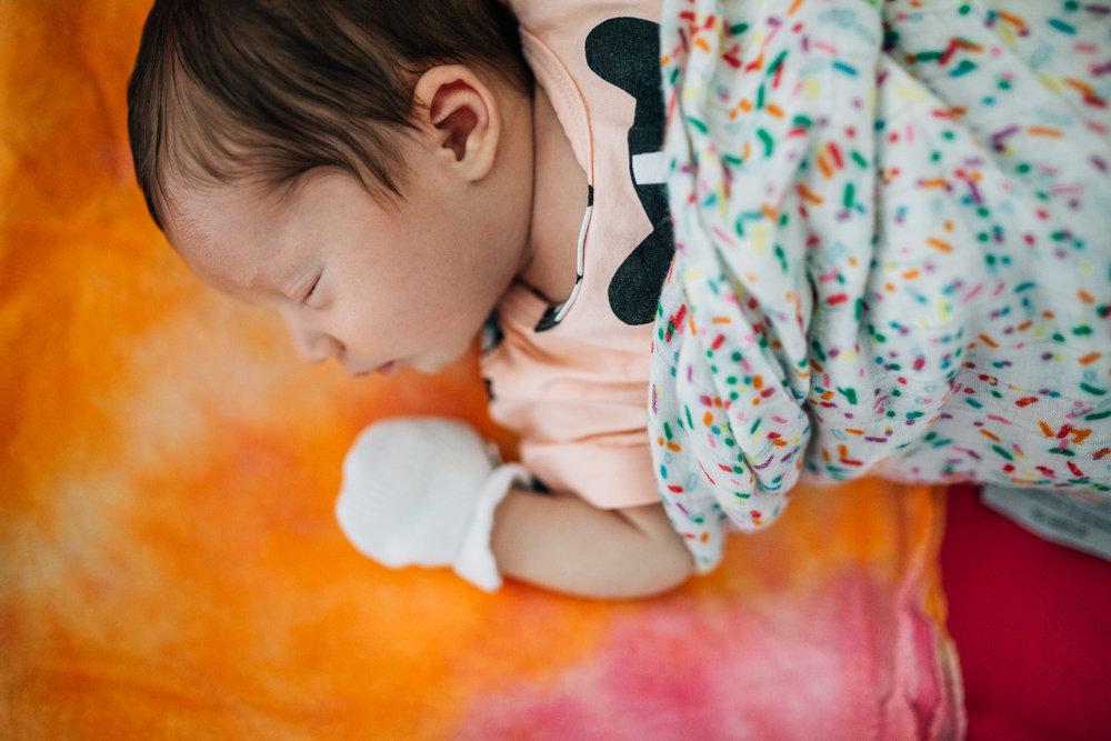 Sam's baby girl, snoozing in her bassinet.
