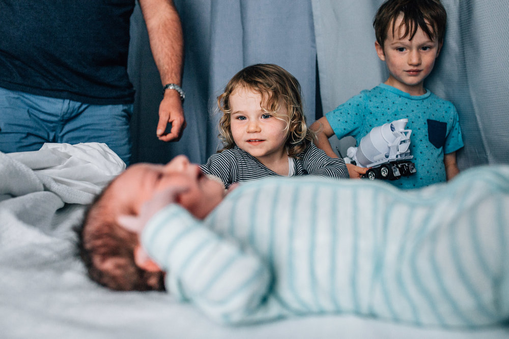 children entering hospital room to meet baby (1 of 1).jpg