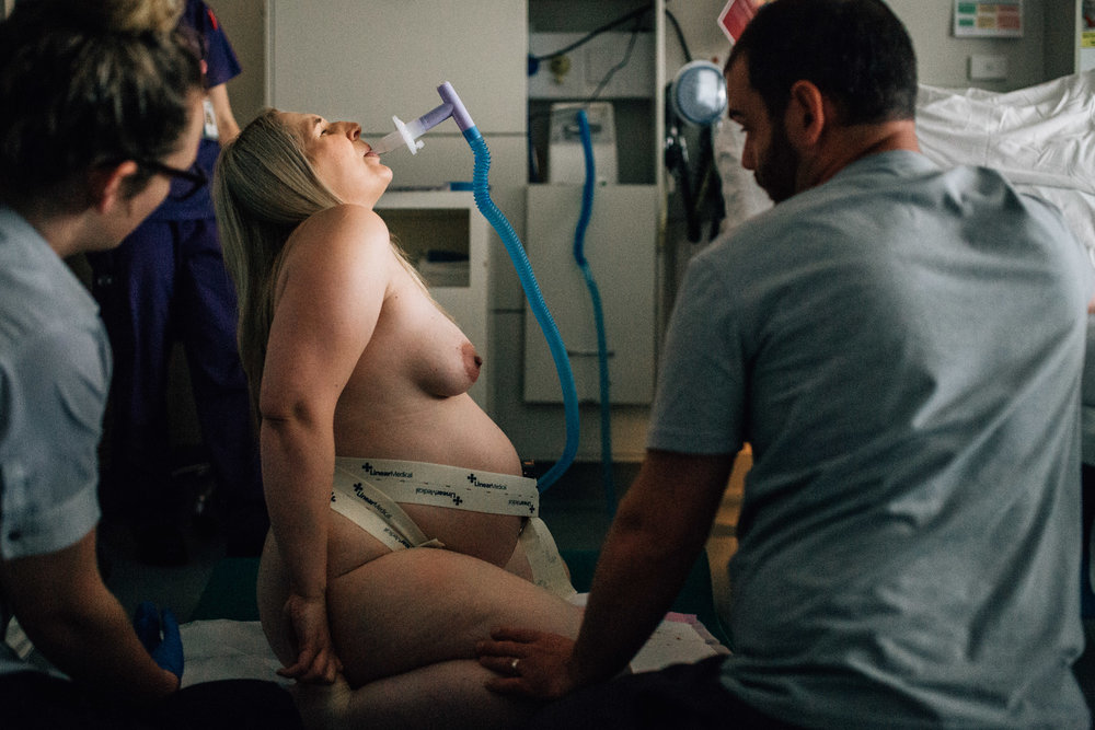 mother kneeling on hospital floor while labouring profile (1 of 1).jpg
