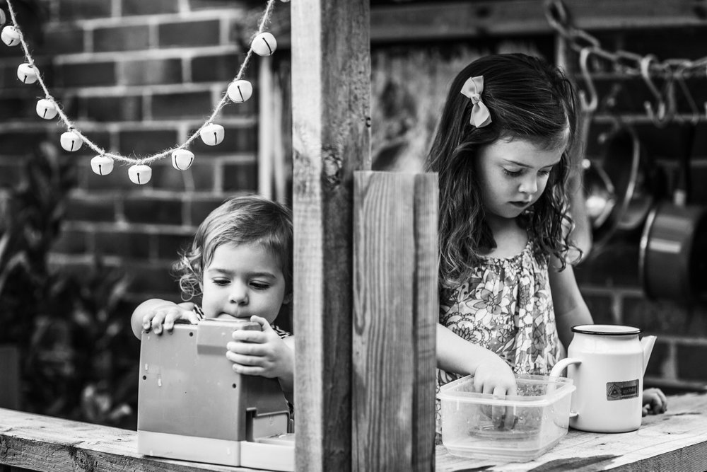 sisters-playing-in-outdoor-cubby (1 of 1).jpg