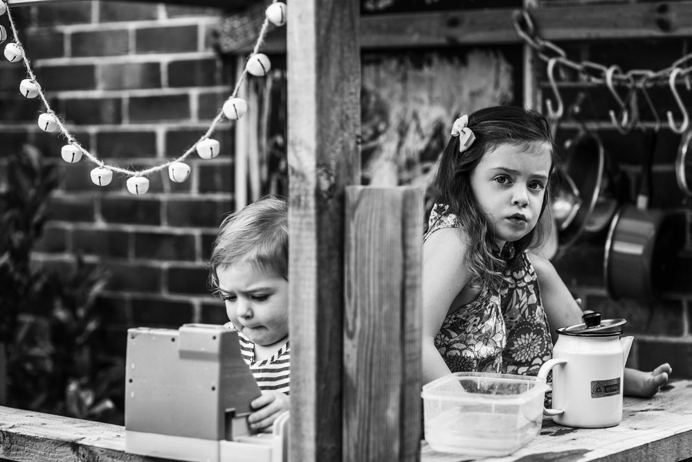sisters-playing-in-outdoor-cubby-II (1 of 1).jpg