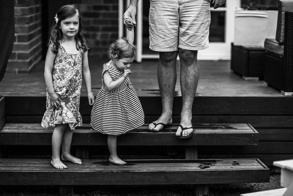 little-girls-on-step-with-father (1 of 1).jpg
