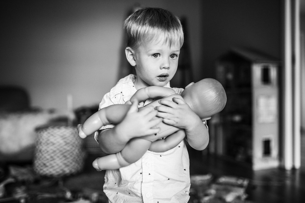 little-boy-nursing-baby-doll-in-playroom (1 of 1).jpg