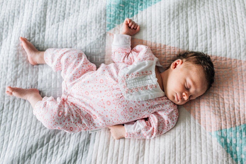 newborn-baby-girl-sleeping-on-parents-bed (1 of 1).jpg