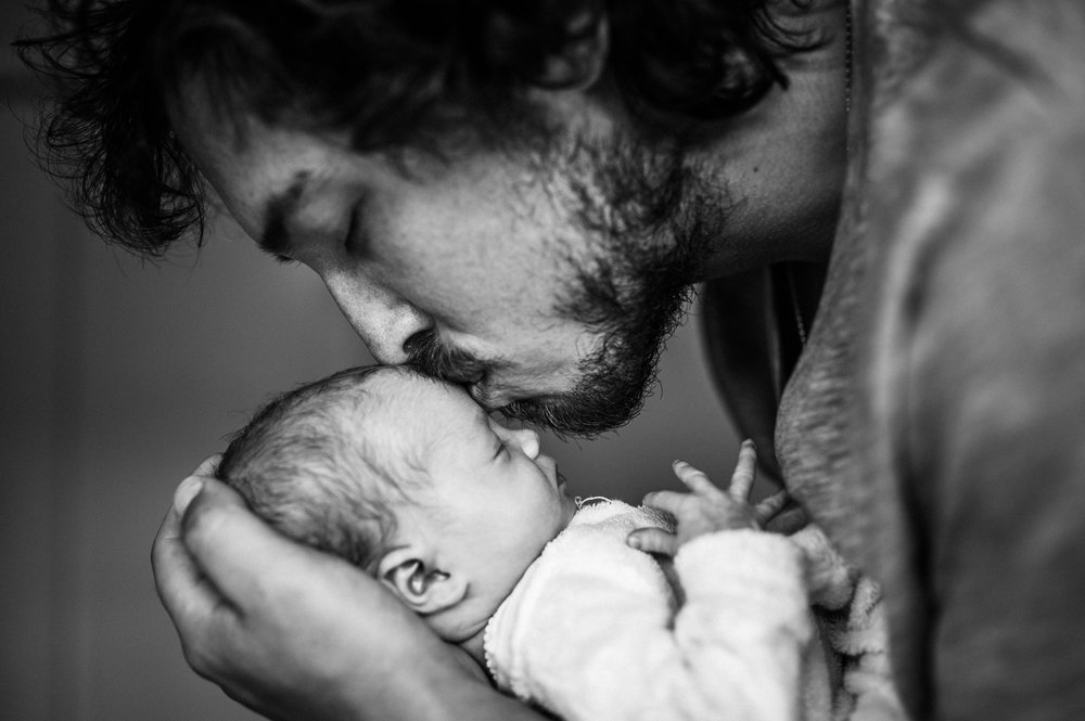 father-kissing-newborn-baby-girl-on-top-of-head (1 of 1).jpg