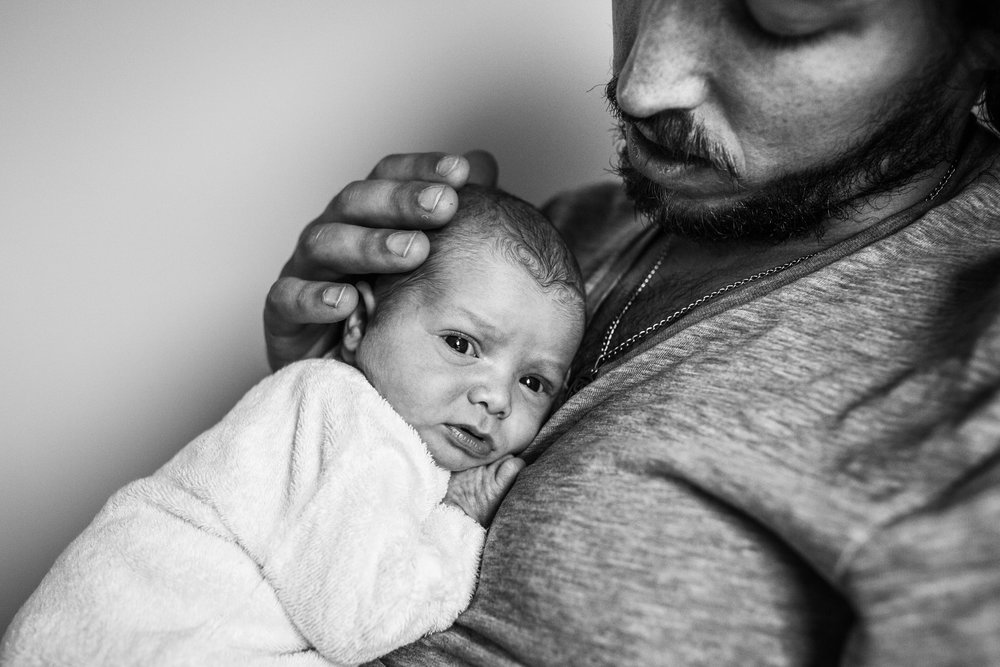 newborn-baby-snuggling-against-fathers-chest (1 of 1).jpg