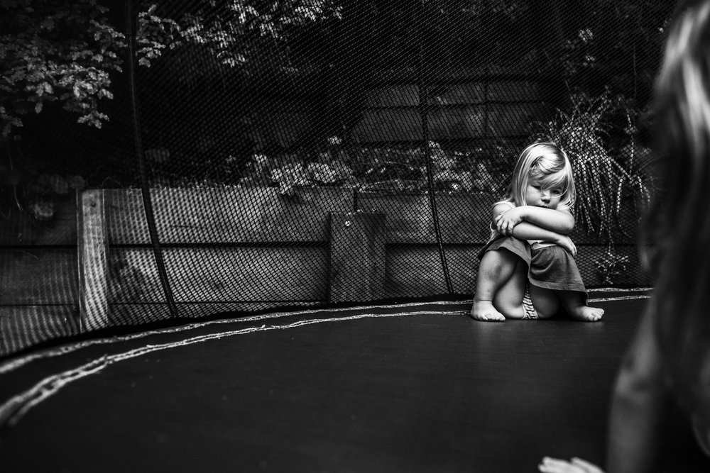 little-girl-pouting-on-trampoline (1 of 1).jpg
