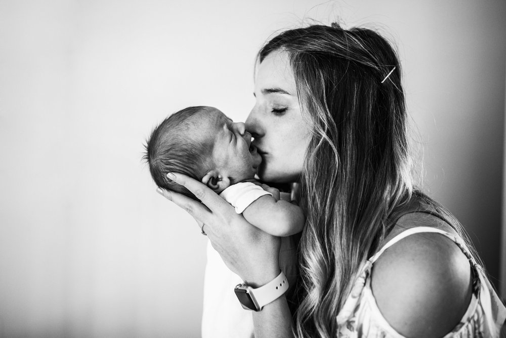 mother-kissing-crying-baby-BW (1 of 1).jpg
