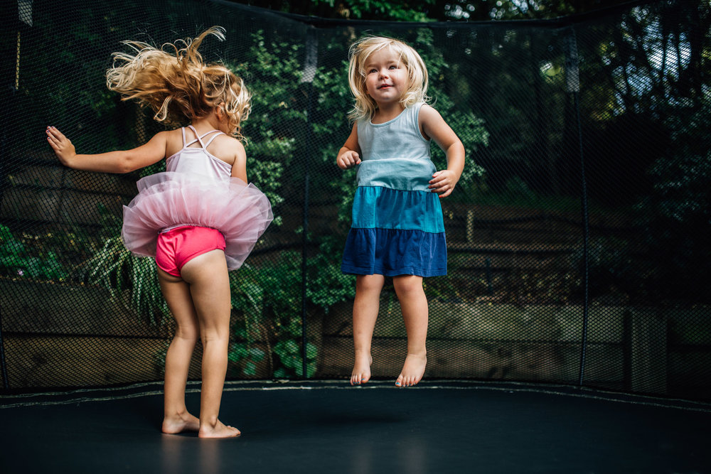 little-girls-jumping-together-on-trampoline (1 of 1).jpg