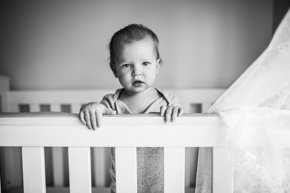 baby boy in cot behind lace curtain IV (1 of 1).jpg