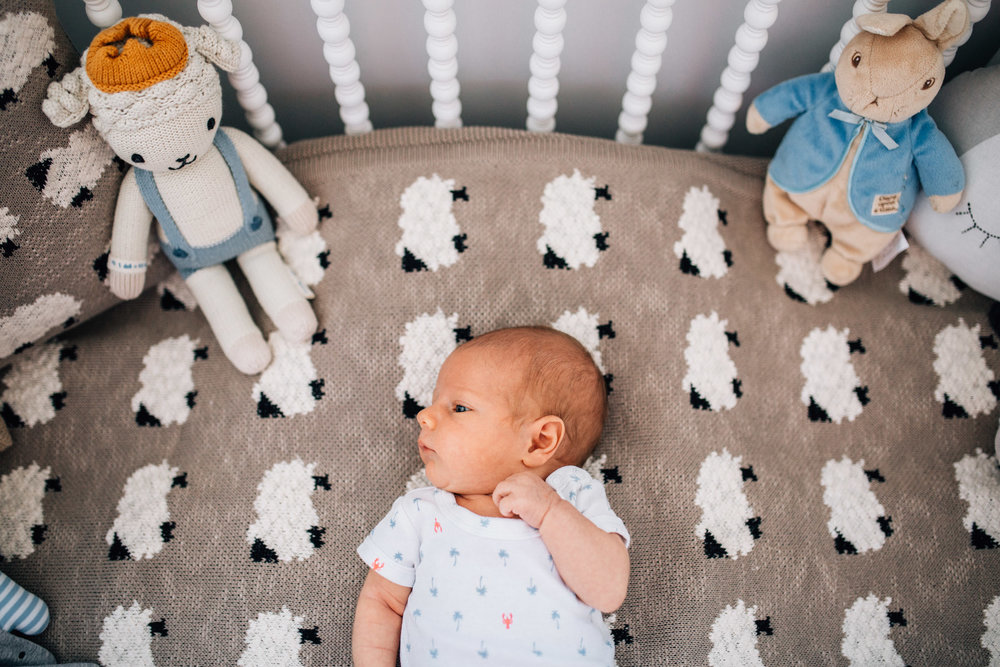baby-relaxing-in-cot-with-sheep-bedding (1 of 1).jpg
