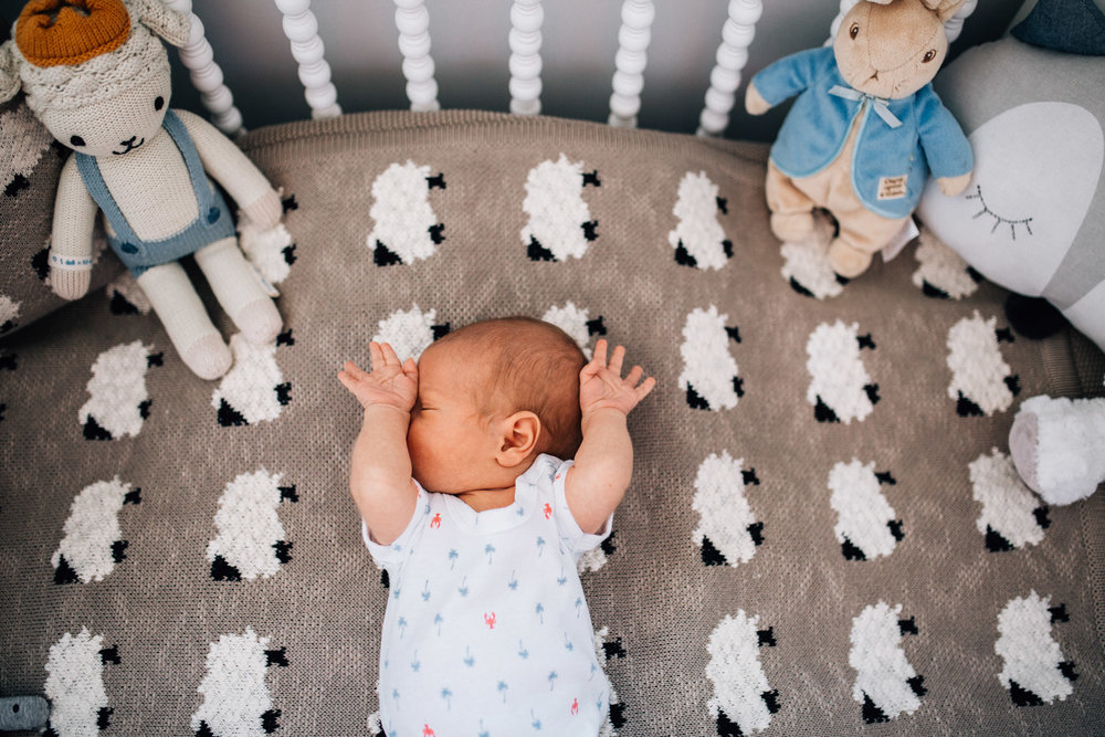 baby-relaxing-in-cot-with-sheep-bedding-II (1 of 1).jpg