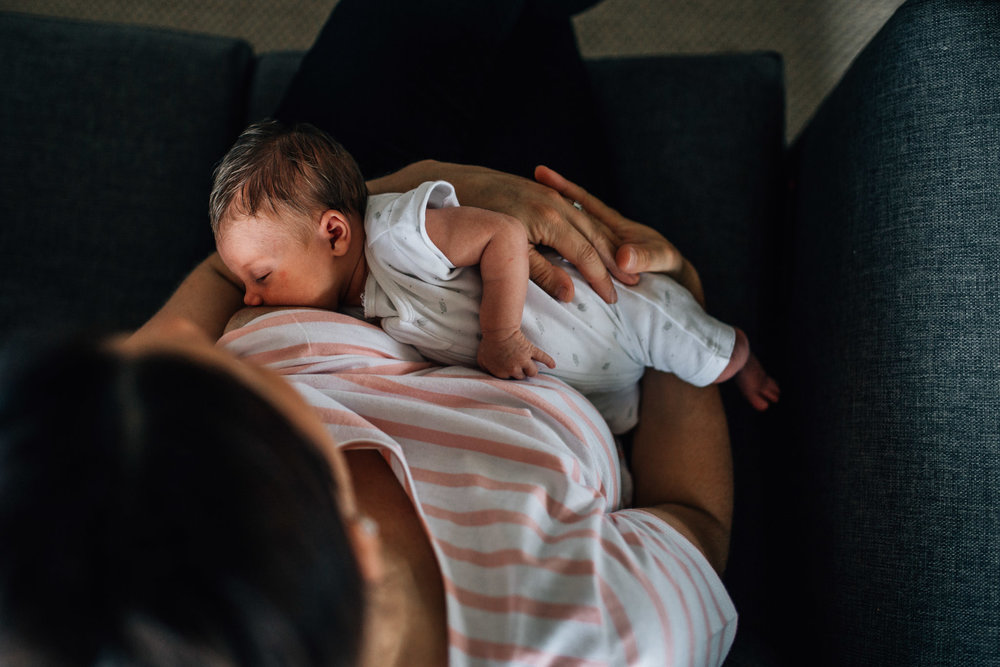 baby-breastfeeding-on-grey-sofa (1 of 1).jpg