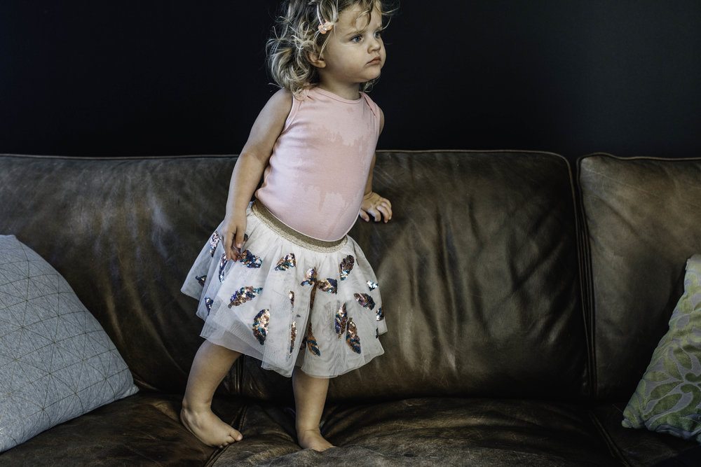 little-girl-standing-on-sofa.jpg