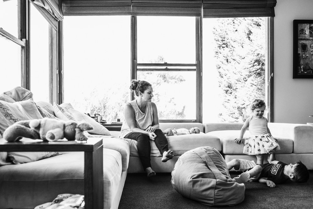 three-children-in-living-room-with-mother.jpg
