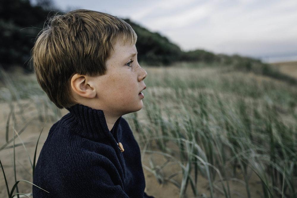 little-boy-on-grassy-beach.jpg