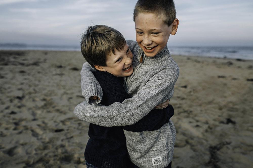 brothers-hugging-on-beach.jpg