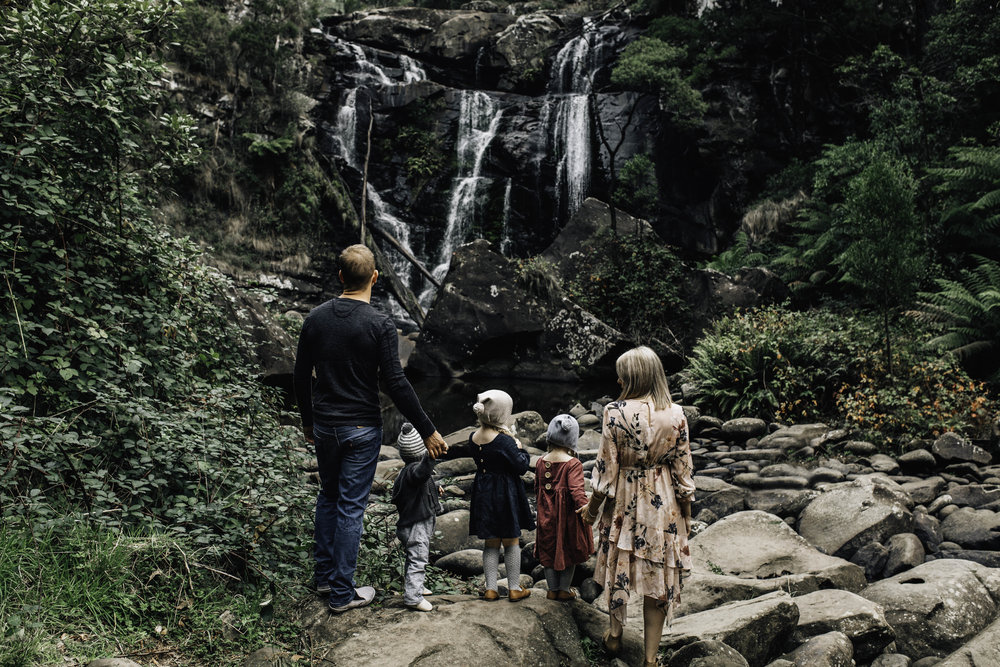 family-looking-out-at-water-fall.jpg