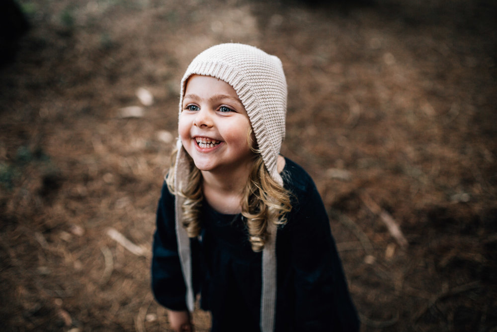 little-girl-grinning-in-forest (1 of 1).jpg