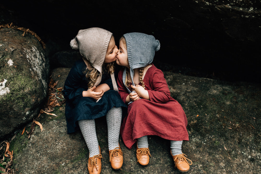 little-girl-in-rocky-alcove-kissing (1 of 1).jpg