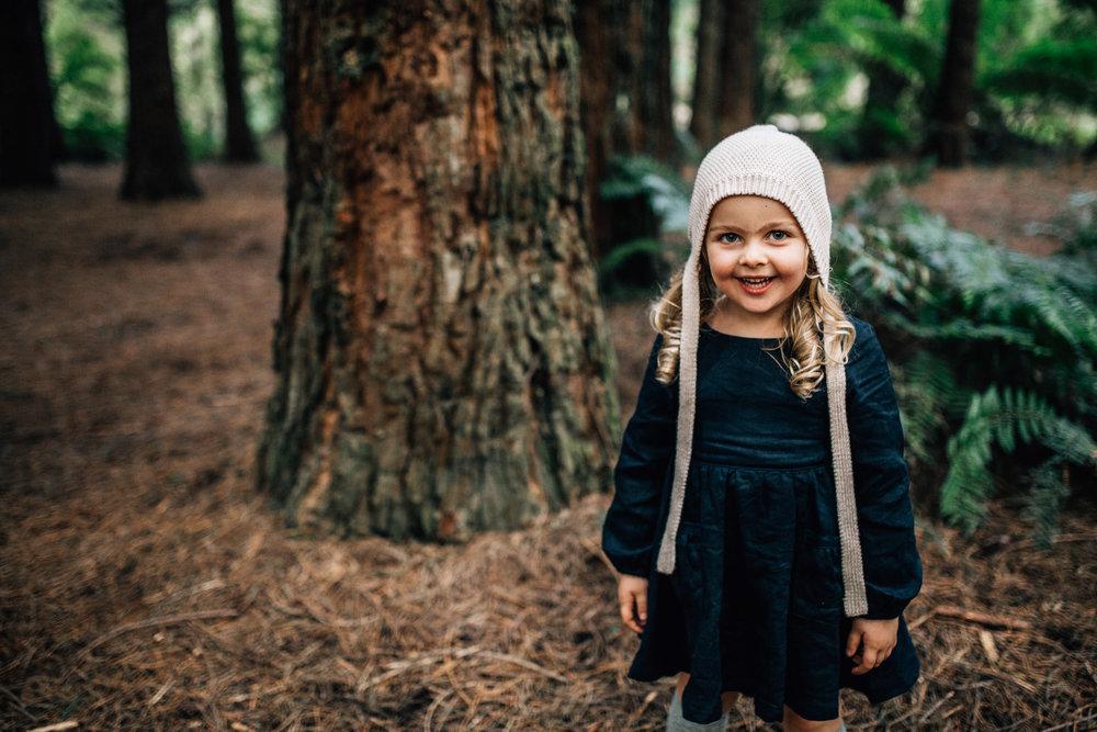 little-girl-smiling-in-forest (1 of 1).jpg