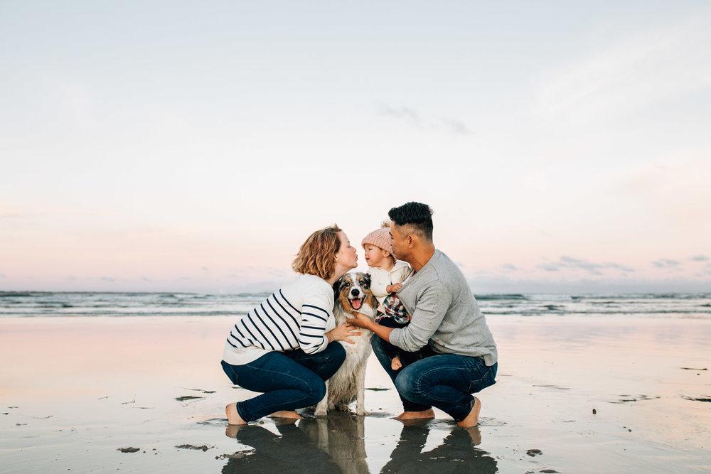 family-hugging-on-wet-sand (1 of 1).jpg