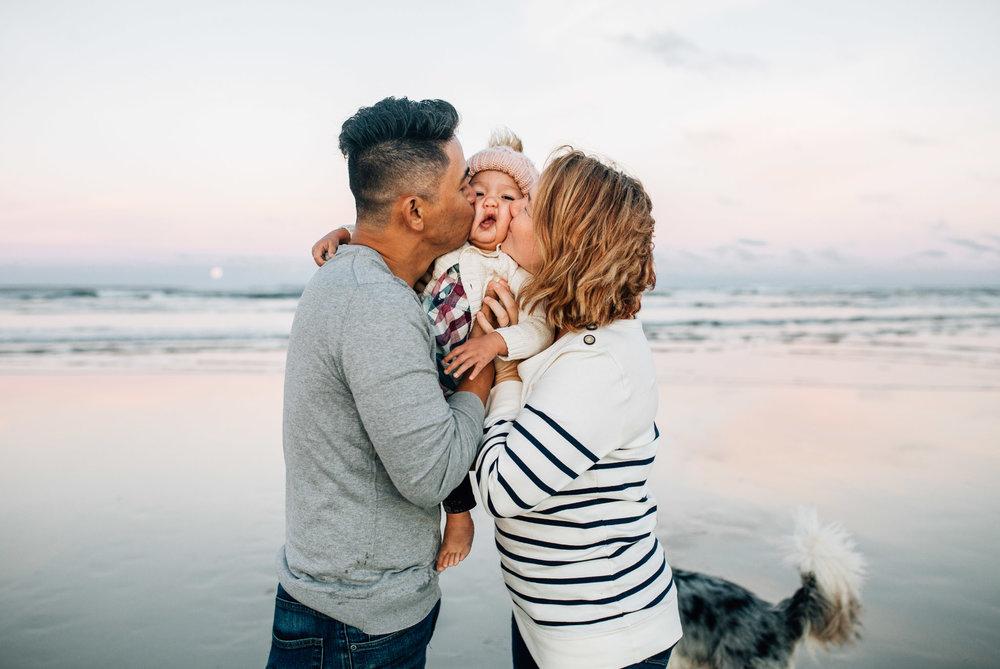 family-hugging-on-wet-sand-II (1 of 1).jpg