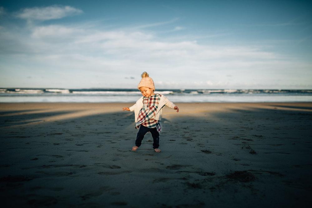 toddler-girl-dancing-on-sand (1 of 1).jpg