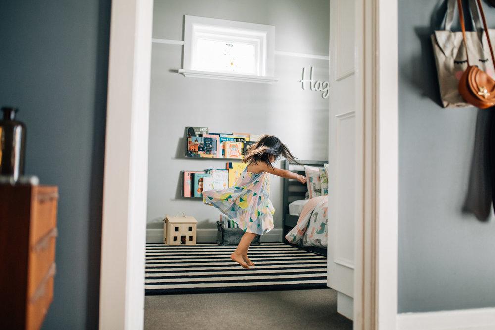 little-girl-twirling-in-bedroom (1 of 1).jpg