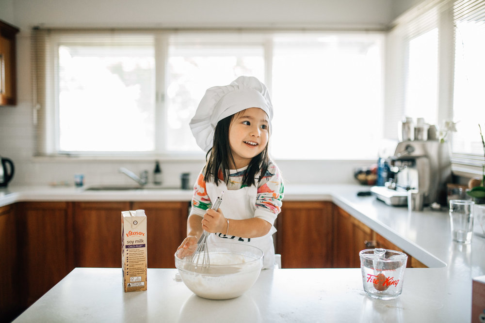 little-girl-cooking-pancakes-with-chef-hat (1 of 1).jpg