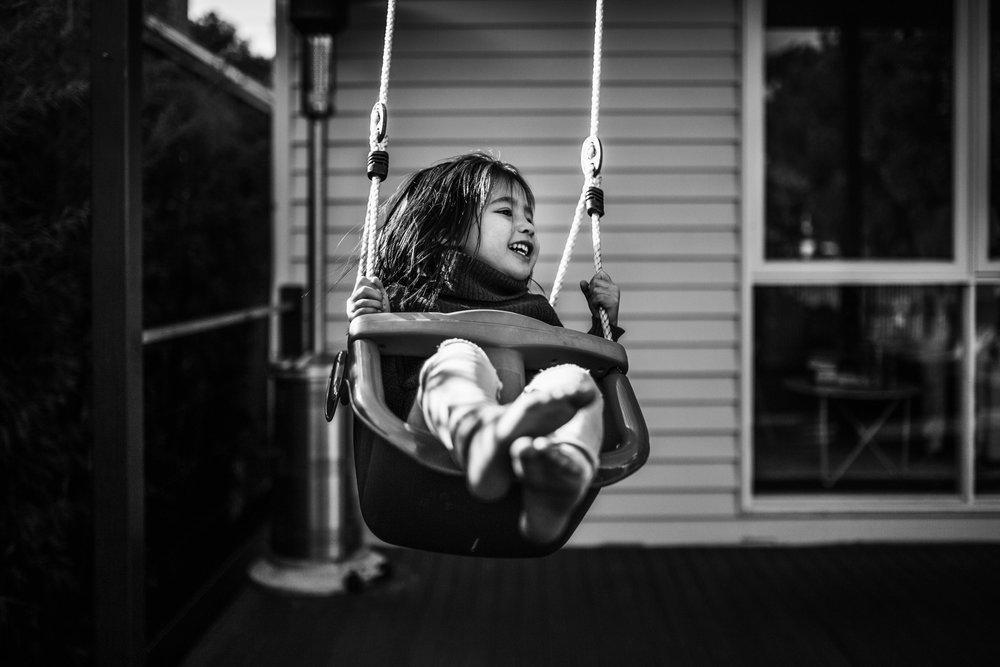 little-girl-flying-on-swing (1 of 1).jpg