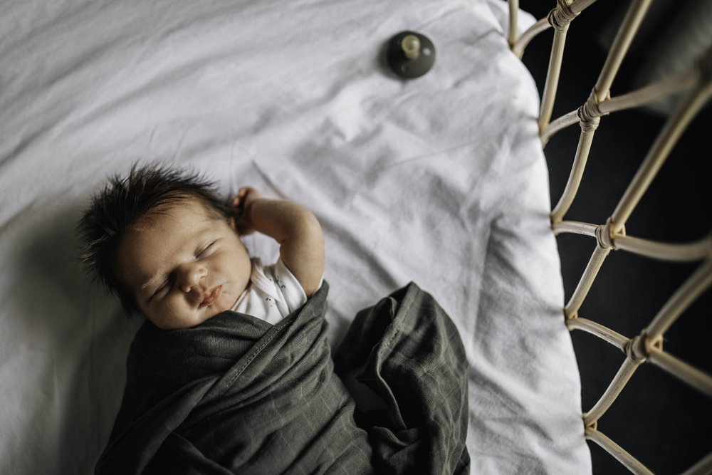 sleeping-baby-whicker-crib.jpg